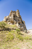Turkey, Cappadocia. Picturesque rocks with the ancient cave monastery in Open Air Museum of Goreme Royalty Free Stock Photos