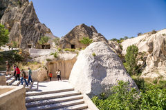 Turkey, Cappadocia. Tourists visiting the cave monastery complex at the Open Air Museum of Goreme Stock Image