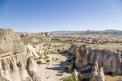 Turkey, Cappadocia. Valley in the vicinity Cavusin with carved into the rock houses - caves Stock Images