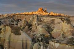 Turkey. Cappadocia. View on rock-castle of Uchisar. Town across a Guyercinlik valley at a sunrise Stock Image