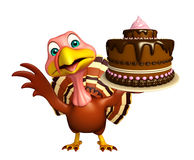 Turkey  cartoon character  with cake Royalty Free Stock Images