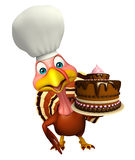 Turkey cartoon character  with chef hat and cake Royalty Free Stock Photos