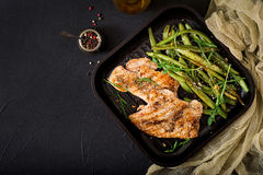 Turkey- chicken fillet cooked on a grill and garnish of green beans. Royalty Free Stock Image