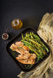 Turkey- chicken fillet cooked on a grill and garnish of green beans. Stock Images