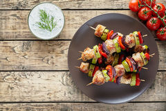Turkey or chicken meat shish kebab skewers with tzatziki Royalty Free Stock Photo