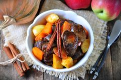 Turkey (chicken) stewed liver in a dry white wine with pumpkin, apple and cinnamon sticks Royalty Free Stock Photos