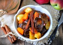 Turkey (chicken) stewed liver in a dry white wine with pumpkin, apple and cinnamon sticks Royalty Free Stock Photo