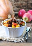 Turkey (chicken) stewed liver in a dry white wine with pumpkin, apple and cinnamon sticks Royalty Free Stock Photography