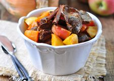 Turkey (chicken) stewed liver in a dry white wine with pumpkin, apple and cinnamon sticks Royalty Free Stock Image