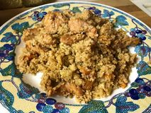 Turkey with couscous, apricots, raisins and walnuts. royalty free stock image