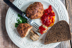 Turkey cutlets with sweet pepper jam closeup. Stock Photography