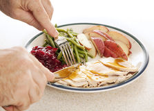 Turkey Dinner. Man's hands eating a delicious turkey dinner for Thanksgiving or other meal Royalty Free Stock Photos