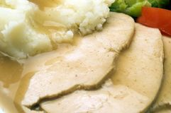 Turkey dinner. Carved white meat turkey breast with vegetables and mashed potatoes Royalty Free Stock Images