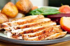 Turkey dinner with crispy skin, turkey slices and fr stock photography