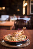 Turkey drumstick and cooked cabbage in restaurant Royalty Free Stock Image