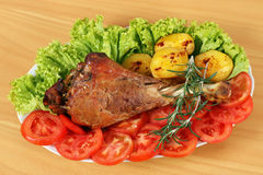Turkey drumstick with potatoes Royalty Free Stock Image