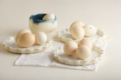 Turkey eggs in three white dishes on light dyed wooden surface. Horizontal royalty free stock photos