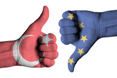 Turkey and Europe flag on human male thumb up and down hands. Turkey  and Europe flag on human male thumb up and down hands Stock Image