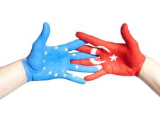 Turkey and european hands holding Royalty Free Stock Image