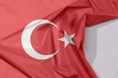 Turkey fabric flag crepe and crease with white space. Turkey fabric flag crepe and crease with white space, a red field with a white star and crescent slightly stock photo