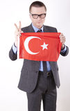 Turkey fan. Man holding flag of Turkey and showing victory sign Royalty Free Stock Image
