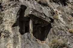 Turkey, Fethiye, Lycian tomb on the rocks above the city. Close-up of the tomb from the interior Stock Image