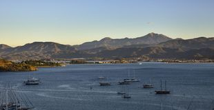 Turkey, Fethiye, view of the bay with yachts and mountains. In the background Stock Photo