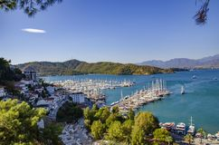 Turkey, Fethiye, view of the harbor with numerous yachts. And beautiful mountains in the background in the rays of the sun Stock Photo