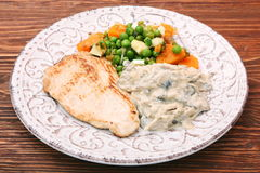 Turkey fillet with mushrooms in cream sauce and vegetables Royalty Free Stock Photography
