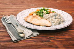Turkey fillet with mushrooms in cream sauce and vegetables Stock Photo