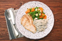 Turkey fillet with mushrooms in cream sauce and vegetables Stock Images