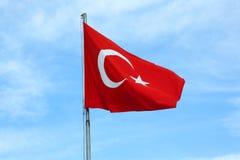 Turkey flag on blue sky background. The Turkey flag on blue sky background stock photography