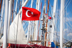 Turkey flag on the boat. At hot sunny day in Bodrum Marina stock image