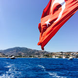 Turkey flag on the boat. A Turkey waving flag attached to the boat with foamy track behind the astern Royalty Free Stock Images