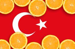 Turkey flag in citrus fruit slices horizontal frame. Turkey flag in horizontal frame of orange citrus fruit slices. Concept of growing as well as import and royalty free stock image