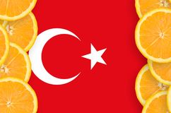Turkey flag in citrus fruit slices vertical frame. Turkey flag in vertical frame of orange citrus fruit slices. Concept of growing as well as import and export stock illustration