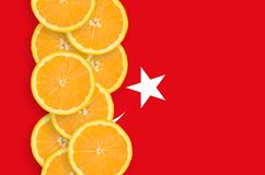 Turkey flag and citrus fruit slices vertical row. Turkey flag and vertical row of orange citrus fruit slices. Concept of growing as well as import and export of royalty free stock photography
