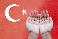 Turkey flag on cloth. Human open empty hands to pray for Turkey on Turkey flag royalty free stock photos
