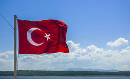Turkey flag and cloudy sky. Turkey flag waving in the evening royalty free stock photo