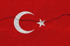 Turkey flag on concrete wall with crack. Patriotic grunge background. National flag of Turkey stock photography