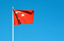 Turkey flag. Turkey country flag waving over blue sky royalty free stock photo