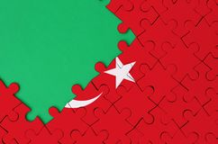 Turkey flag is depicted on a completed jigsaw puzzle with free green copy space on the left side.  royalty free stock photos