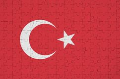 Turkey flag is depicted on a folded puzzle stock photos