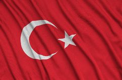Turkey flag is depicted on a sports cloth fabric with many folds. Sport team banner. Turkey flag is depicted on a sports cloth fabric with many folds. Sport team stock photo