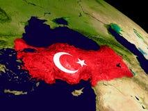 Turkey with flag on Earth Royalty Free Stock Photos