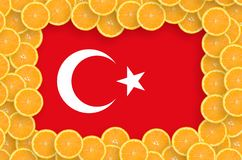 Turkey flag in fresh citrus fruit slices frame. Turkey flag in frame of orange citrus fruit slices. Concept of growing as well as import and export of citrus stock illustration