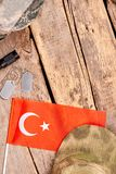 Turkey flag and military essentials. Wooden background. Flat lay, top view royalty free stock image