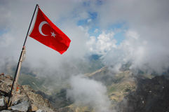 Turkey flag on mountain summit. A Turkish flag planted on the summit of Mount Kackar, 3937m, Turkey stock image