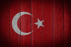Turkey flag. Painted on old wood plank background stock photos