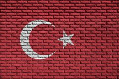 Turkey flag is painted onto an old brick wall royalty free stock photo